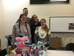 Katrina Recoche (third from left) with students and donated toiletries