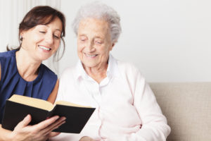 happy-women-young-old-reading-book