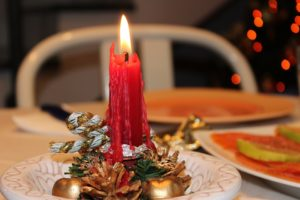 Christmas candle on table